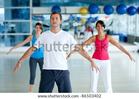 Group of people at the gym stretching - stock photo