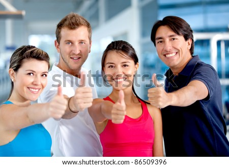 Group of people at the gym with thumbs up - stock photo