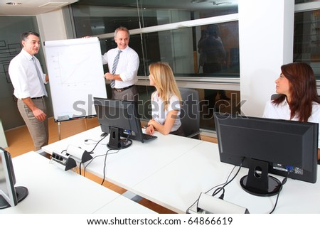 Group of people attending business presentation - stock photo