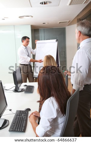 Group of people attending business presentation