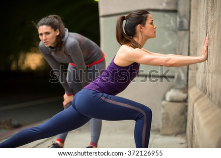 Group of people before a run warming up stretch and prepare for intense calorie burn fitness - stock photo