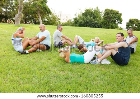 Group of People doing flexibility exercises - stock photo