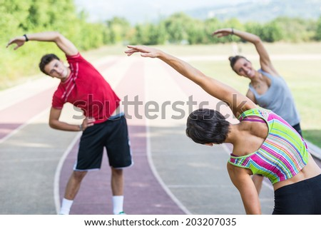 Group of People doing Stretching Exercises - stock photo