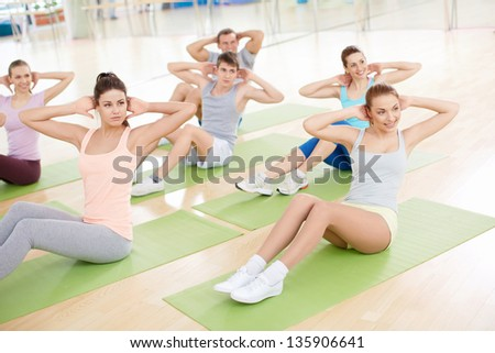 Group of people engage in fitness club