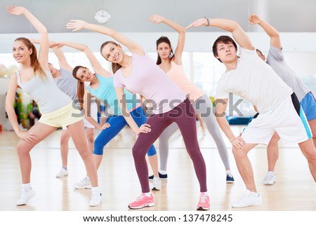 Group of people engaged in fitness club