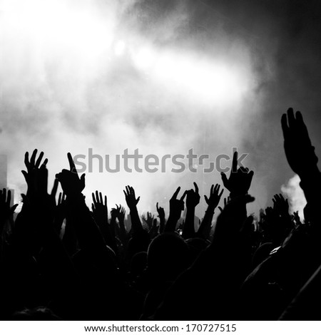 Group of people enjoying a concert - stock photo