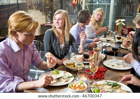 Group of people enjoying a rich dinner in a restaurant