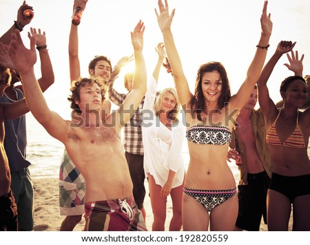 Group of people enjoying a summer beach party. - stock photo
