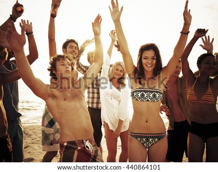 Group of people enjoying a summer beach party Concept - stock photo