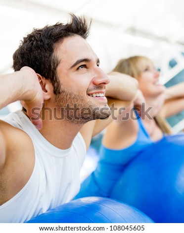 Group of people exercising at the gym - stock photo
