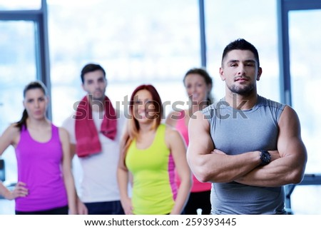 Group of people exercising at the gym and stretching - stock photo