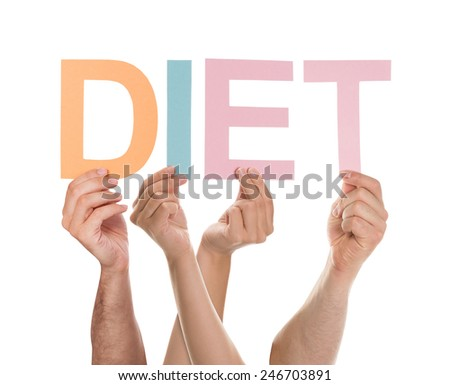 Group Of People Hands Holding Multicolored Diet Text Over White Background - stock photo