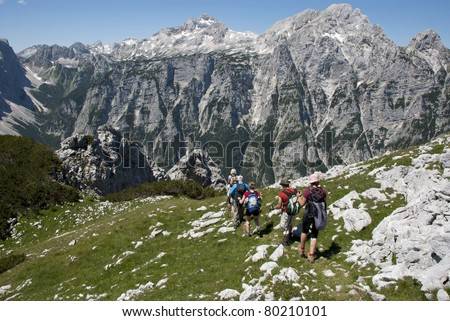 Group of people hiking in Julian Alps - stock photo