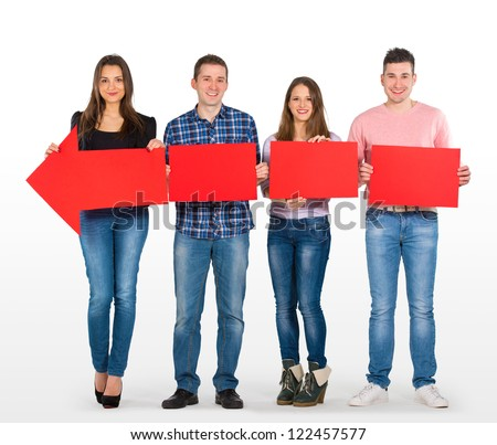 Group of people holding a big, red arrow