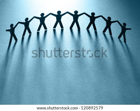 Group of people holding hands. Teamwork concept papercraft - stock photo
