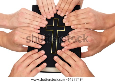 Group of people holding Holy Bible to unity and prayer