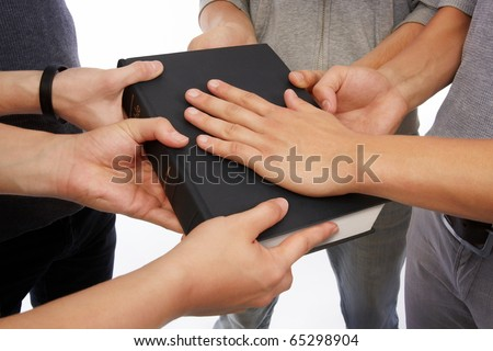 Group of people holding Holy Bible to unity, promises and prayer - stock photo