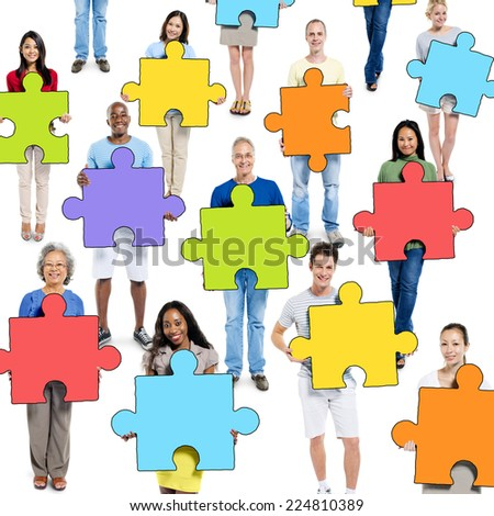 Group of People Holding Jigsaw Puzzle Piece - stock photo