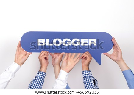 Group of people holding the BLOGGER written speech bubble