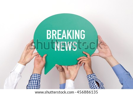 Group of people holding the BREAKING NEWS written speech bubble - stock photo
