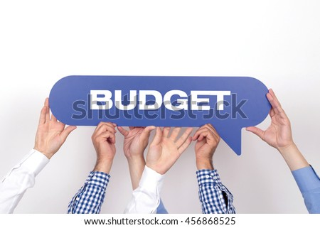 Group of people holding the BUDGET written speech bubble