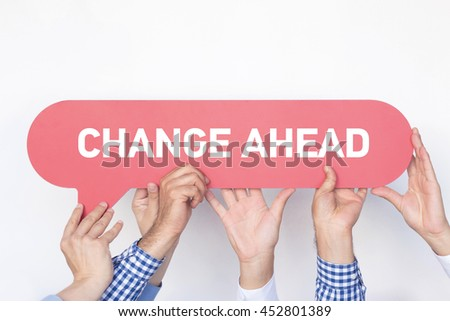Group of people holding the CHANGE AHEAD written speech bubble - stock photo