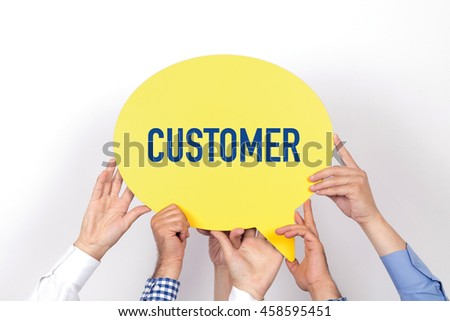 Group of people holding the CUSTOMER written speech bubble - stock photo
