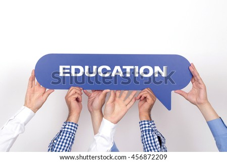 Group of people holding the EDUCATION written speech bubble