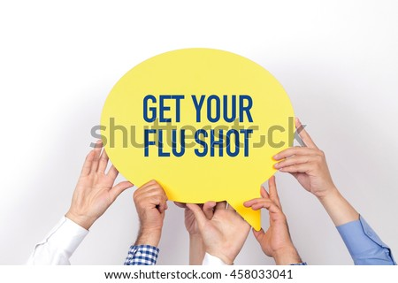 Group of people holding the GET YOUR FLU SHOT written speech bubble - stock photo