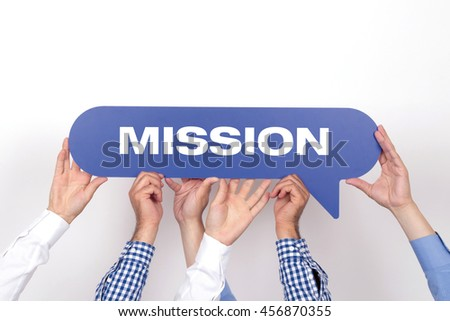 Group of people holding the MISSION written speech bubble