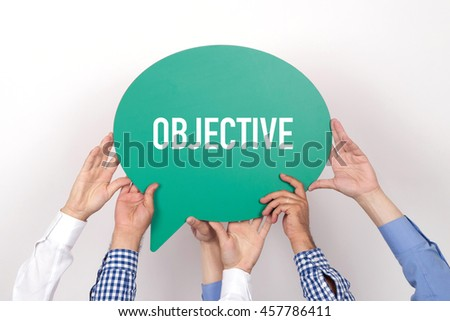 Group of people holding the OBJECTIVE written speech bubble - stock photo