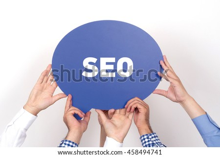 Group of people holding the SEO written speech bubble