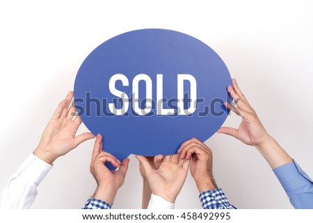 Group of people holding the SOLD written speech bubble