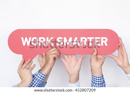 Group of people holding the WORK SMARTER written speech bubble - stock photo