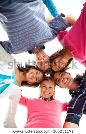 Group of people hugging in a circle isolated over a white background - stock photo