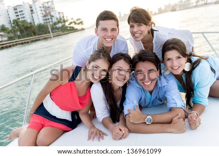 Group of people in a boat enjoying the summer - stock photo