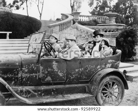 Group of people in a car - stock photo