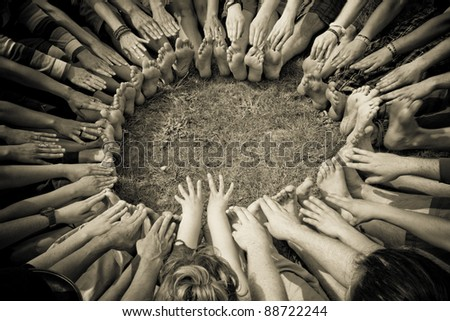 Group of people in a circle stretch and reach for their toes - stock photo