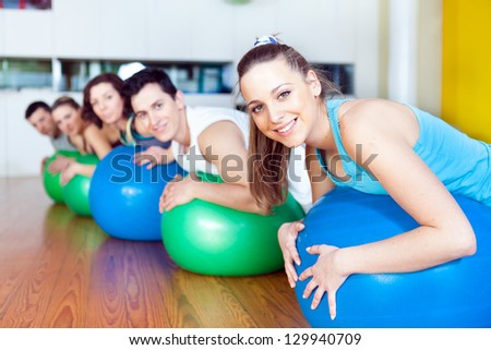 Group of people in a class of Pilates at the gym - stock photo