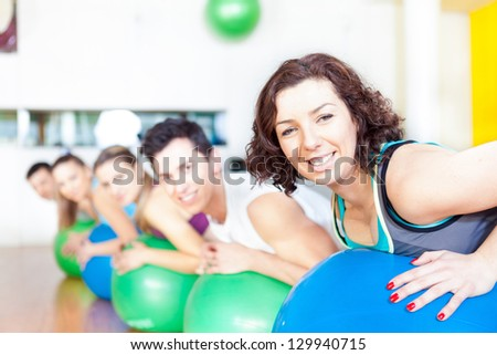Group of people in a class of Pilates at the gym