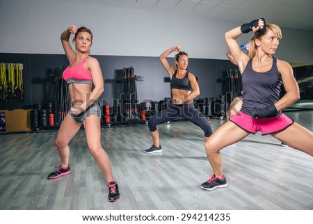 Group of people in a hard boxing training on fitness center - stock photo
