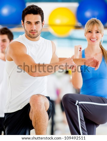 Group of people in an aerobics class at the gym - stock photo