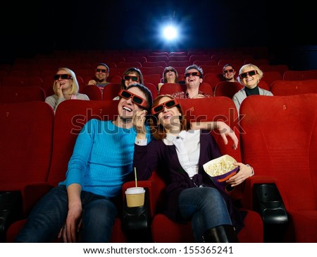 Group of people in 3D glasses watching movie in cinema - stock photo