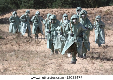 Group of people in protective suits - stock photo
