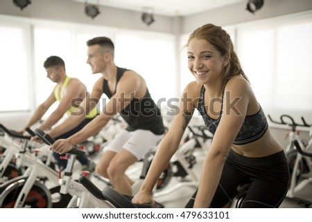Group of people in spinning gym room