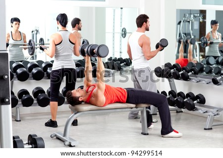 group of people in sport fitness gym weight training equipment indoor - stock photo