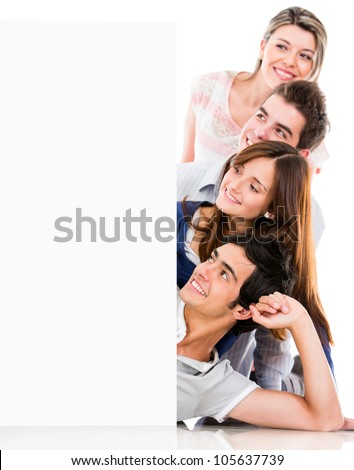 Group of people looking at a banner - isolated over white background - stock photo