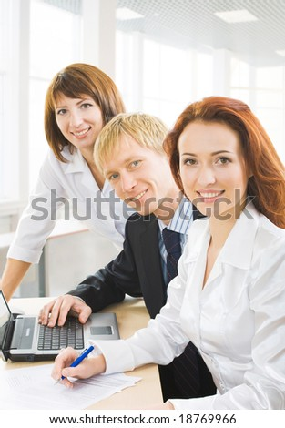 Group of people, looking at camera and smiling. - stock photo