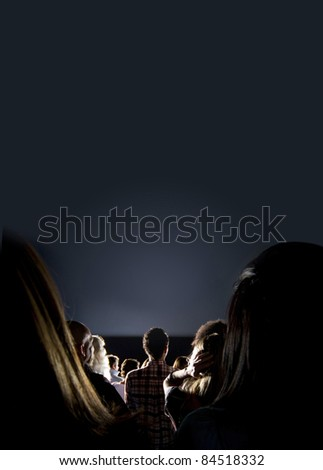 Group of people looking at the screen at the cinema - stock photo