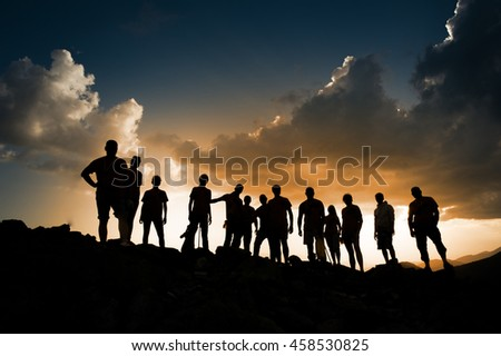 group of people on a background of expressive clouds, Carpathian mountains, Ukraine.